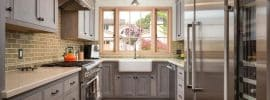 galley-kitchen-with-gray-cabinets-quartz-countertop-and-engineered-oak-floors