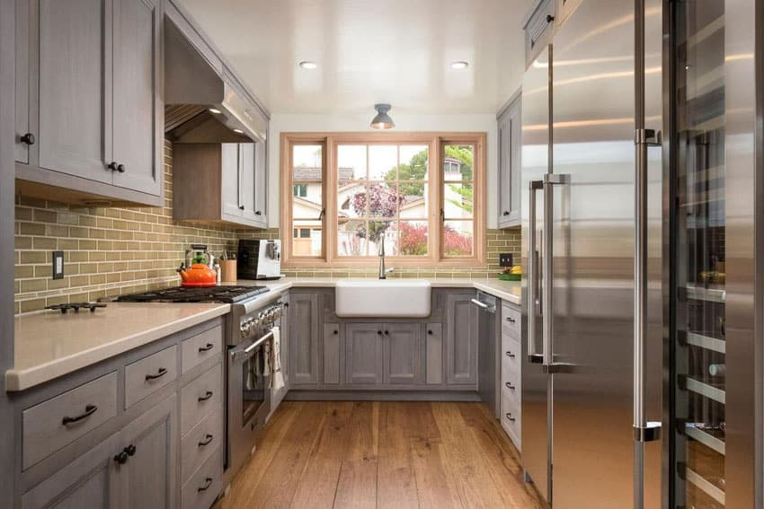 Galley kitchen with gray cabinets, quartz countertop and engineered oak floors