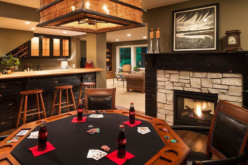 Game room with card table and rustic home bar