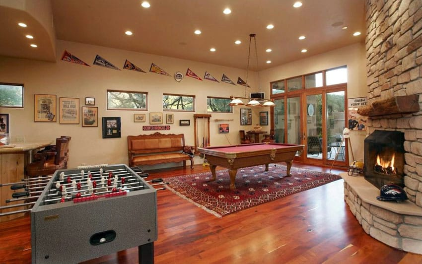 Game room with fireplace and hardwood floors