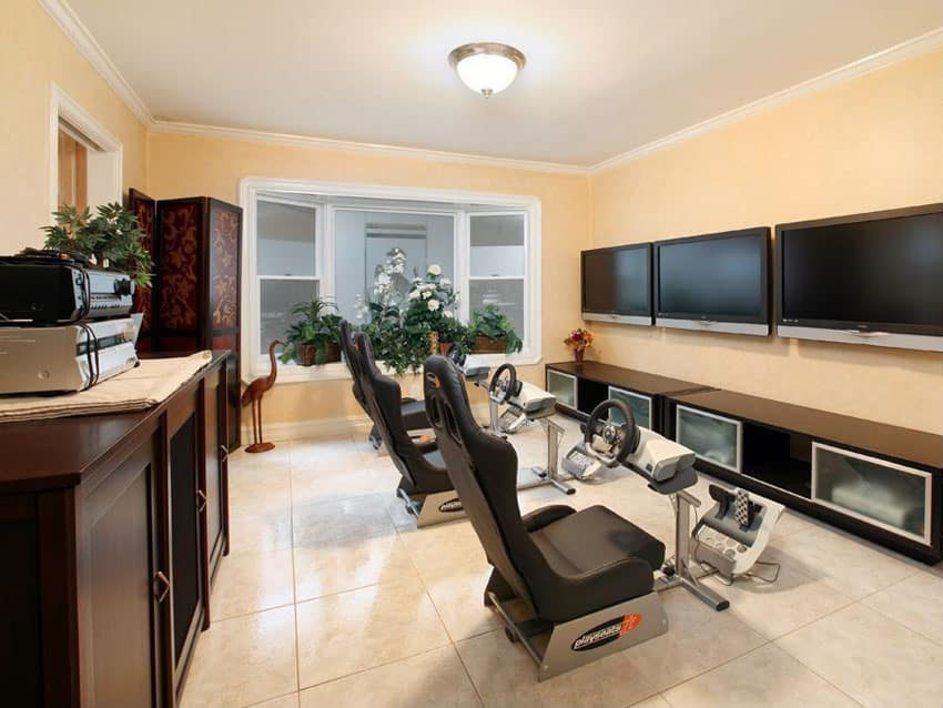 Game room with nascar playseats and tv game monitors