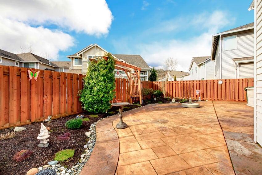 Garden fence with wood pergola