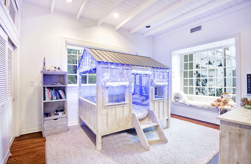 Girls bedroom with clubhouse bed and hanging mood lighting