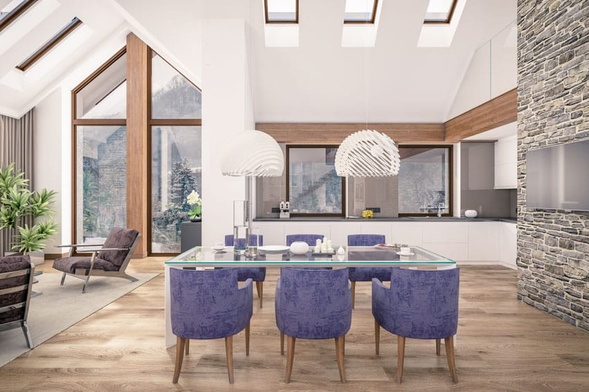 High ceiling dining room with purple chairs and light wood floors