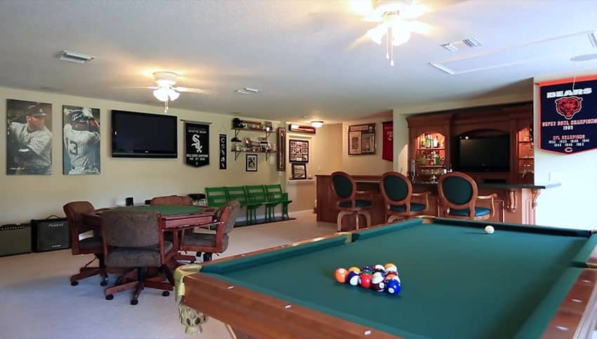 Home man cave with bar pool table and card table