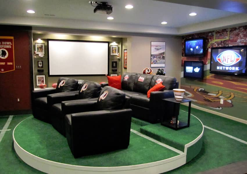 Home theater with leather seating and multiple big screen tvs