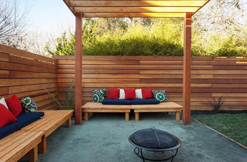 Horizontal wood fence with wood pergola, benches and portable fire pit
