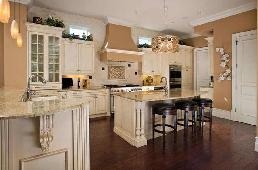 Kitchen with antique white cabinets and dark engineered mahogany floors