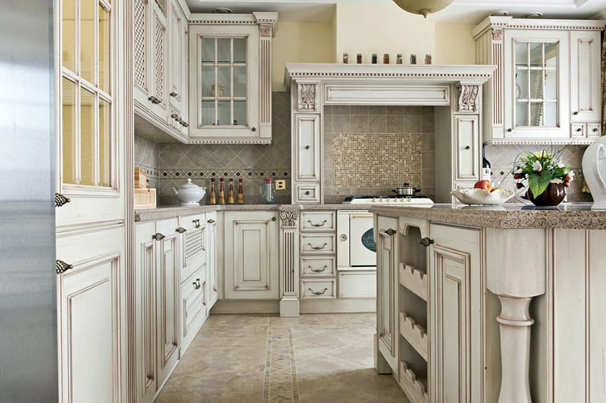 Kitchen with custom antique white cabinets with glass doors