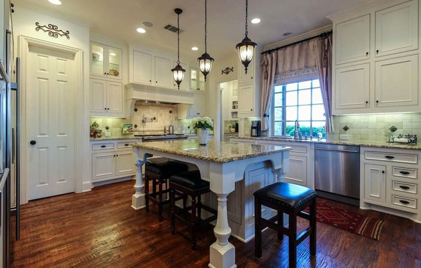 Kitchen with recessed panel antique white style cabinets, dark wood floors and white island