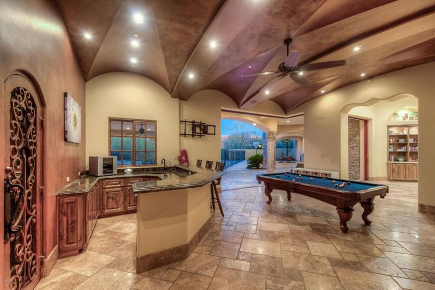 Large high ceiling game room with home bar