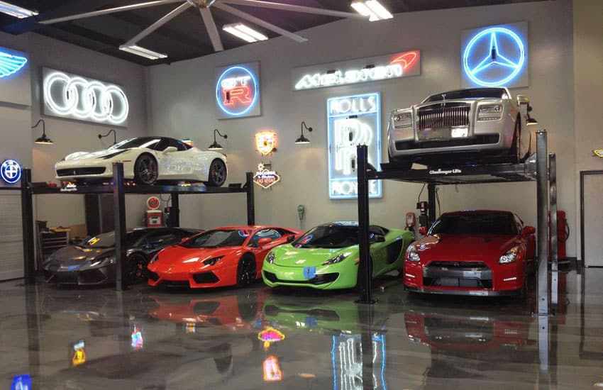 Luxury cars in modern garage with polished floors