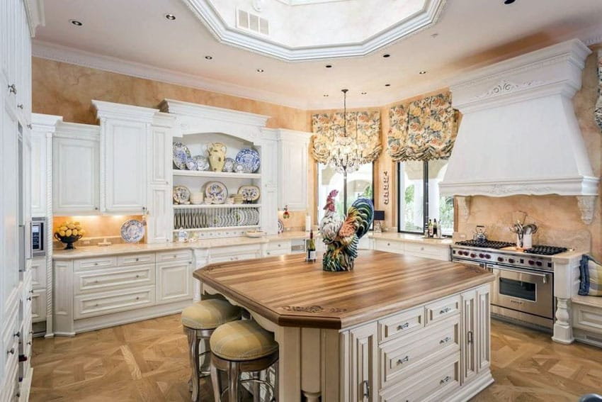 Luxury country kitchen with decorative white wood cabinetry, wood counter island and skylight cupola