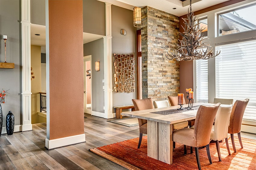 Luxury dining room with high ceilings orange decor