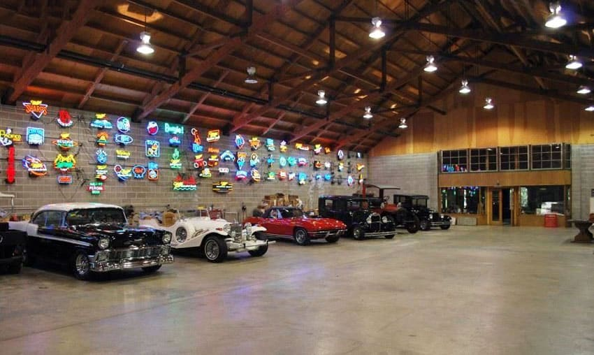 Luxury garage with collector cars and neon signs