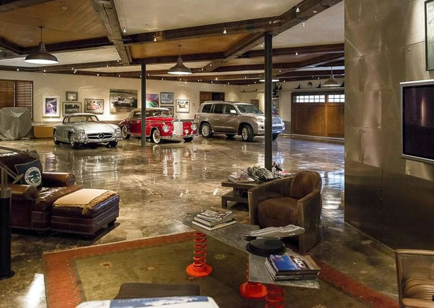 Luxury garage with lounge chairs and tv
