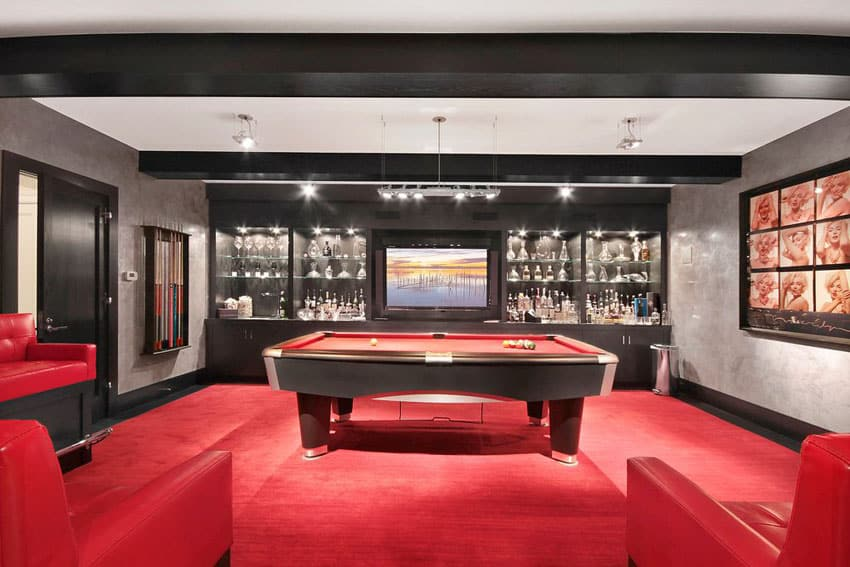 Luxury man cave with red and black decor and alcohol bar