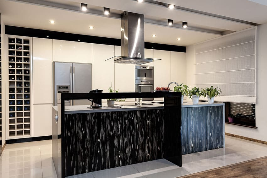 Luxury modern kitchen with white cabinets, black patterned island and wine storage