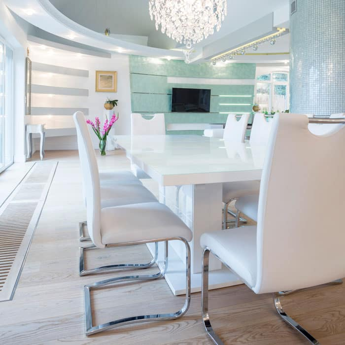 Luxury modern white dining room with chandelier