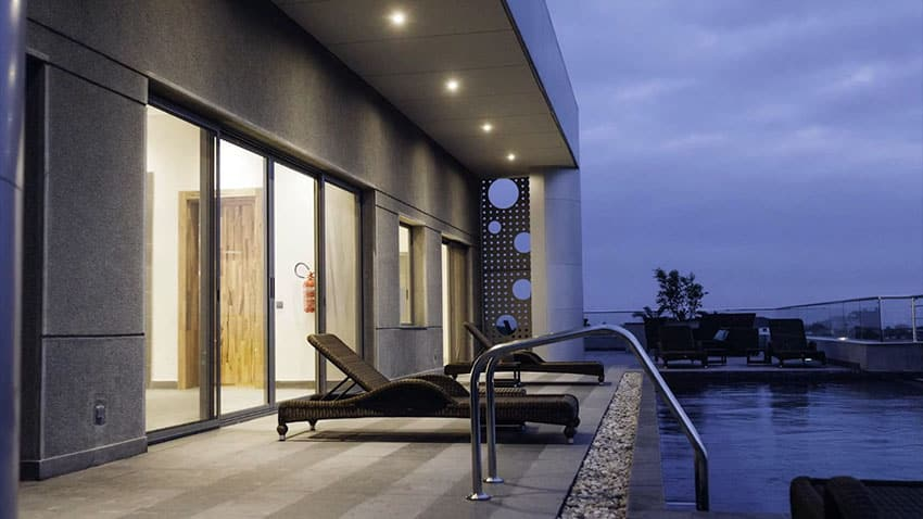 Luxury rooftop apartment swimming pool at night