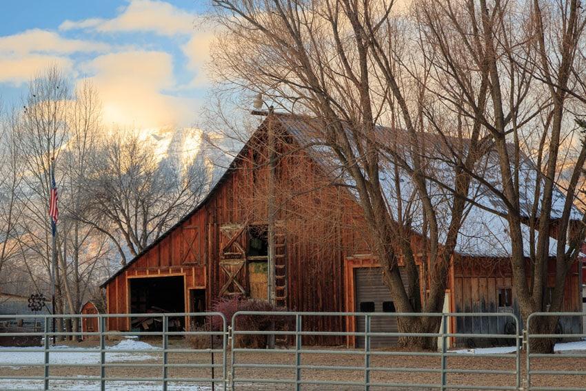 Metal farm fence with barn