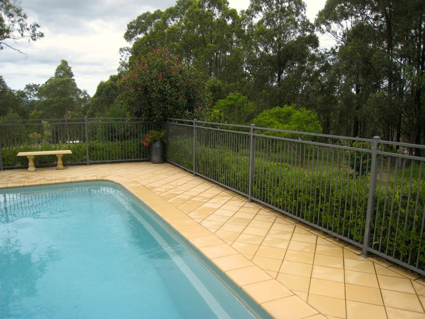 Metal swimming pool fence in gray