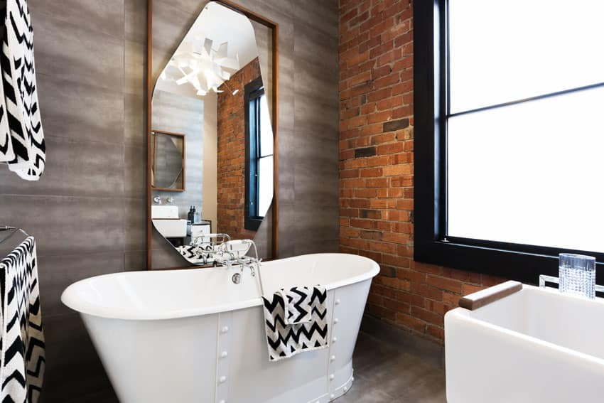 Modern bathroom with brick accent wall