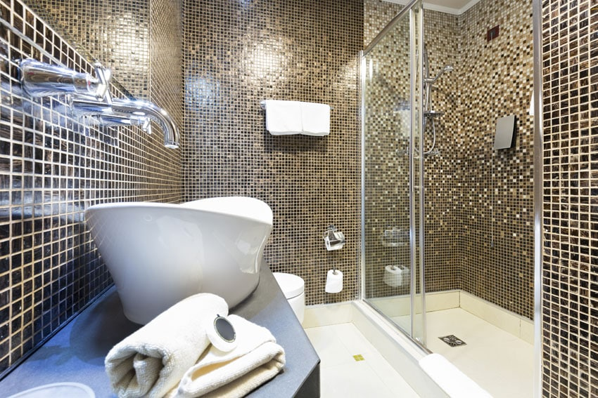 Modern bathroom with floor to ceiling gold mosaic tile