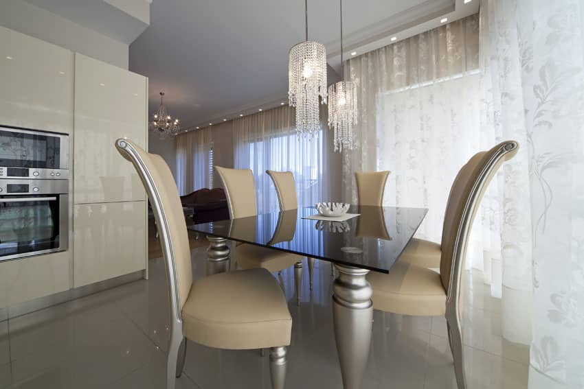 Modern beige dining room with glass chandelier pendant lights