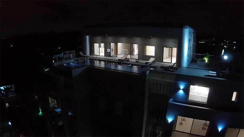 Modern custom designed apartment with rooftop swimming pool at night