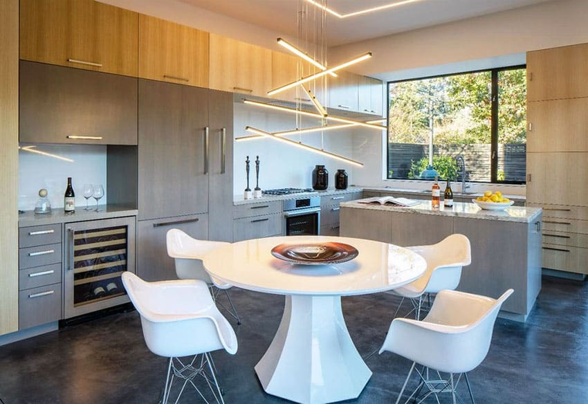 Modern dining room with all white table, chairs and hanging bars light fixture