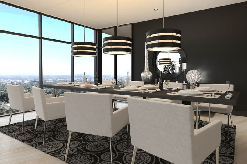 Modern dining room with black accent wall and drum pendant lights