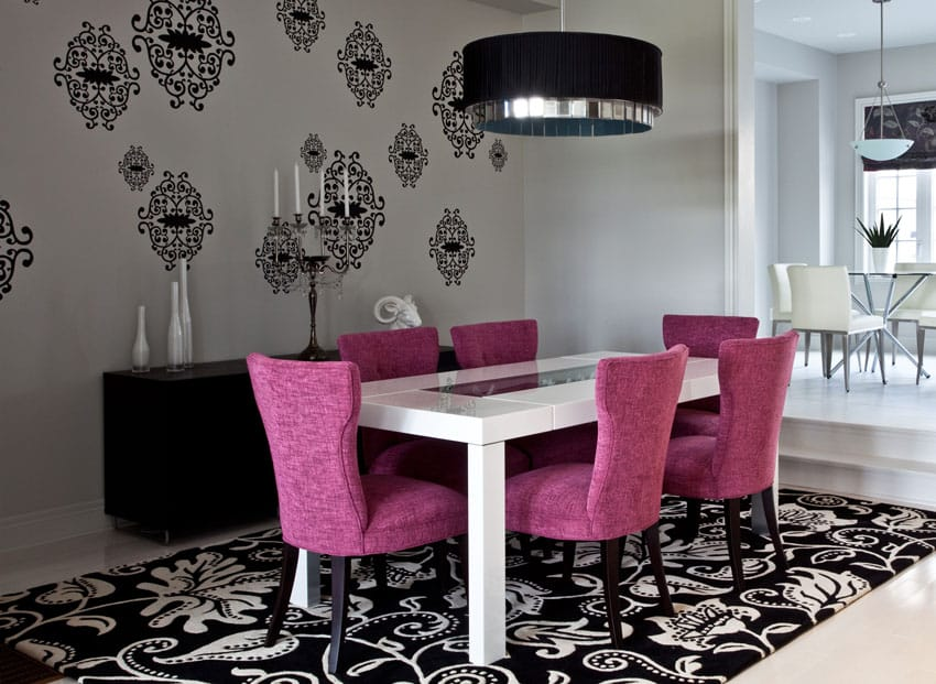 Modern dining room with purple chairs, drum pendant light and large patterned area rug