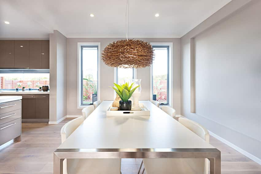 Modern dining table with custom wood weave light fixture