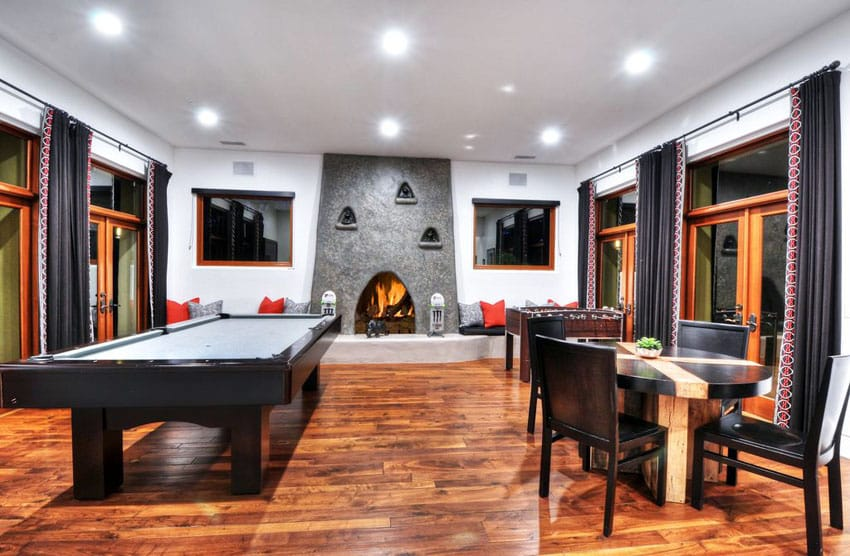 Modern game room with wood flooring and fireplace