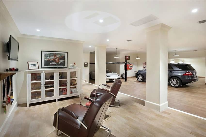 Modern garage with leather chairs and lounge area