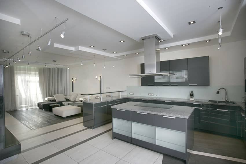 Modern kitchen with grey cabinets, white countertops and open layout