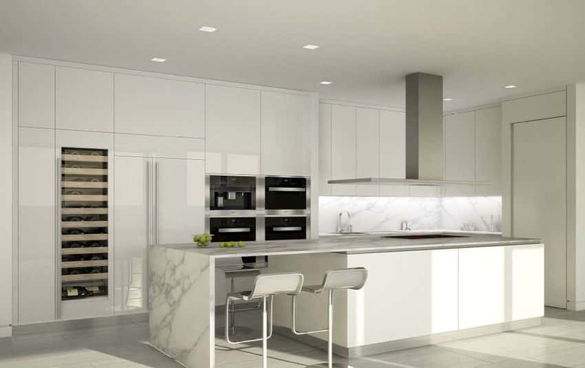 Modern kitchen with white cabinets, rectangular island with breakfast bar and wine fridge
