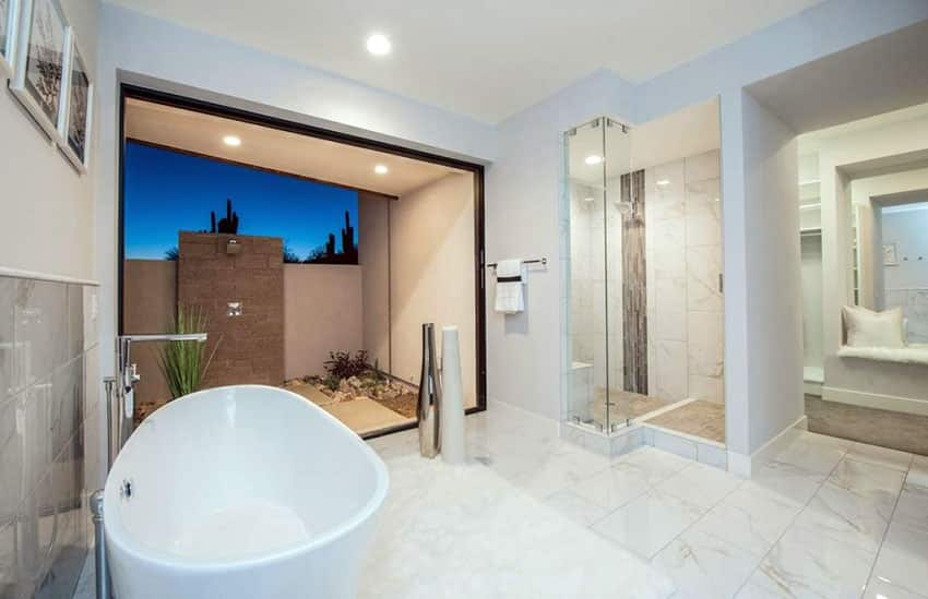 Modern master bathroom with marble tile window view from bathtub