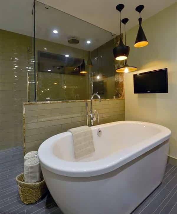 Modern master bathroom with slate tile floor, freestanding tub and black pendant lights