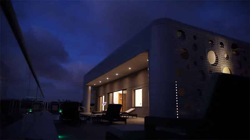 Modern rooftop swimming pool at night