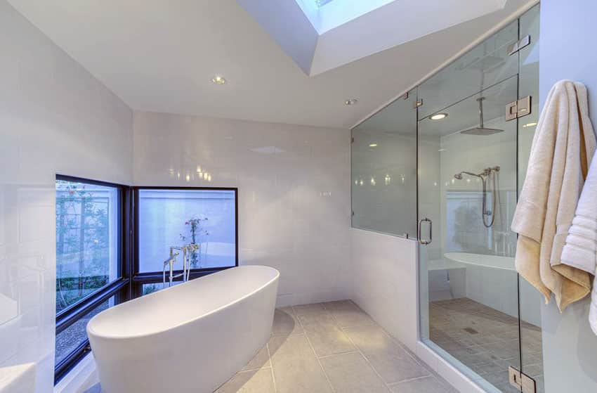 Modern white bathroom with large shower with rainfall showerhead