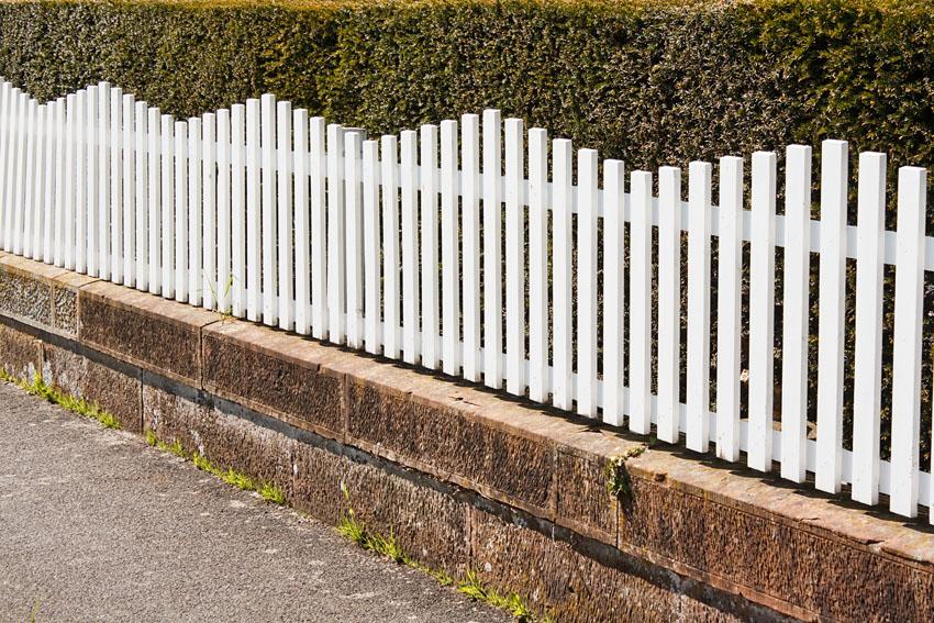 Modern white picket fence