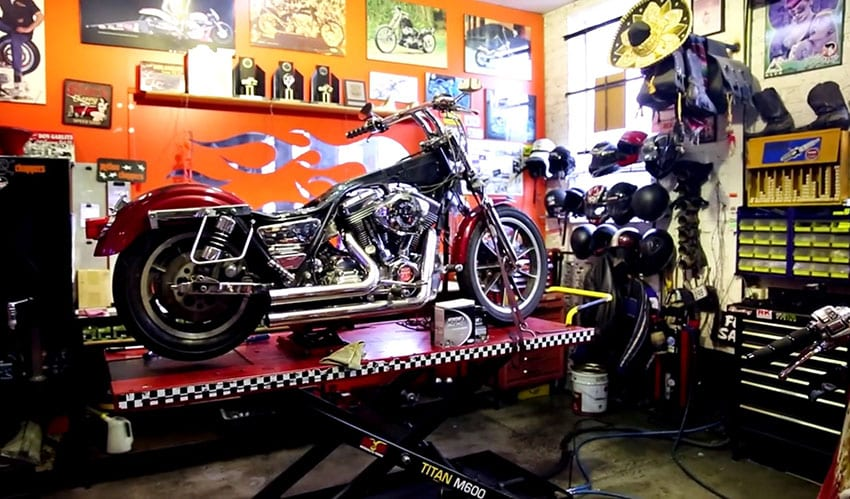 Mechanics man cave with tools and motorcycle