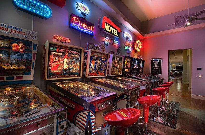 Pinball machine game room with neon signs