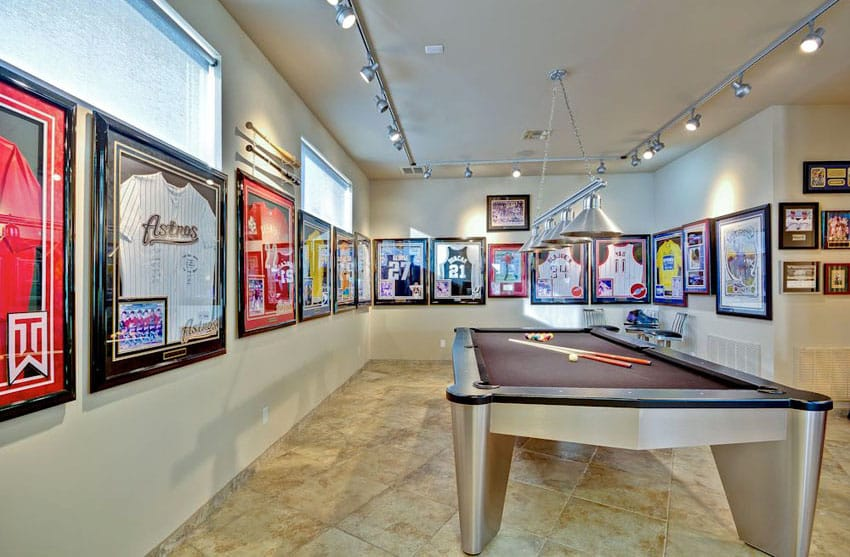 Pool table room with sports team jerseys