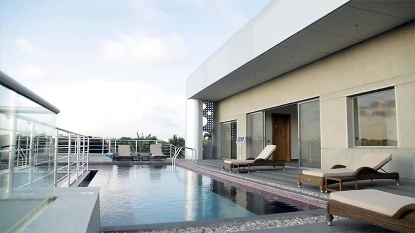 Rooftop apartment swimming pool with lounge chairs