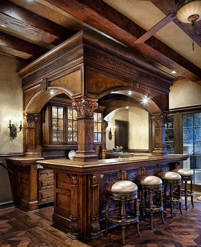 Rustic wood home wet bar with glass door cabinetry