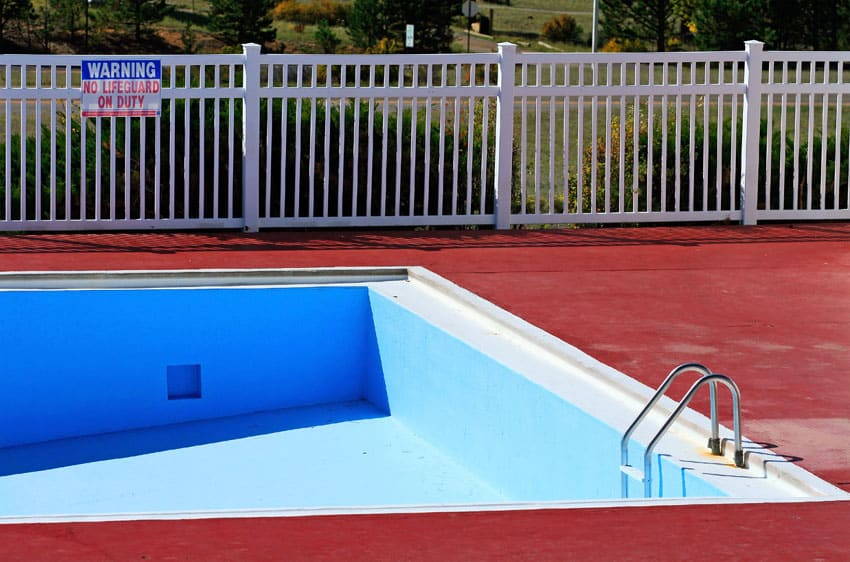 White swimming pool security fence