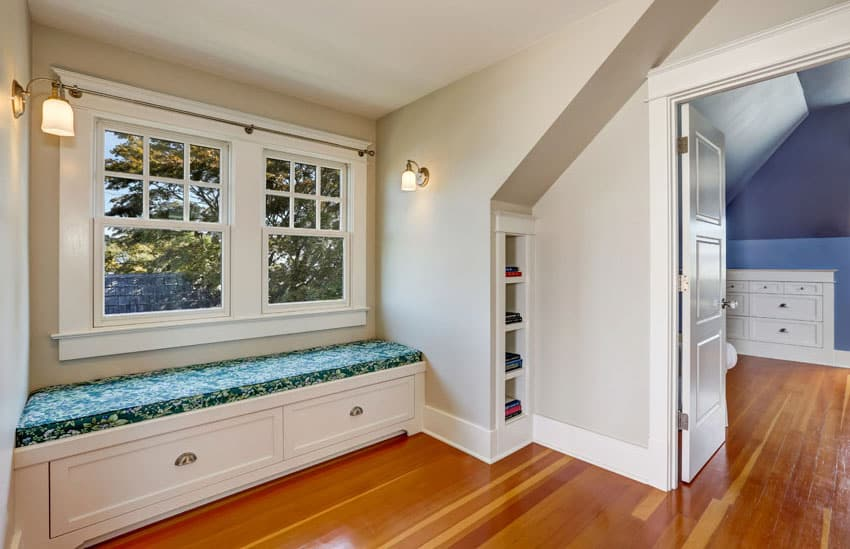 Built-in window bench placed by a double casement window